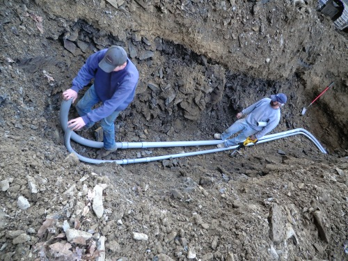 Installing Conduit for Electrical and Cable service.